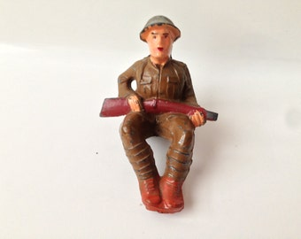 Manoil Toy Soldier Sitting with Rifle on Lap M-059 Sitting Soldier