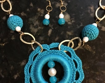 Set of handmade blue crochet necklace and earrings