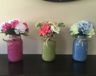 Painted mason jars with silk flowers