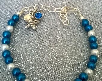 Metallic Blue Beaded Bracelet With Starfish Charm