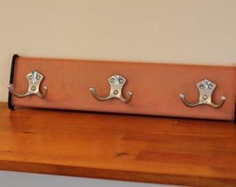 Vintage 50's pink skai leather coat rack / mid century / modernist / wall mounted