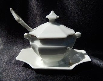 Old Porcelain gravy boat of Paris