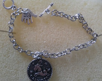 Zodiac and personalised named bracelet.
