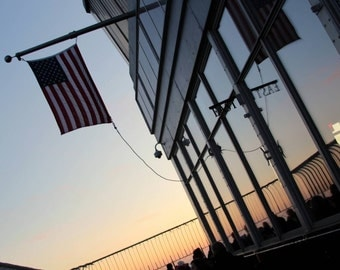 american flag on top of the empire state building in New York at sunset, NYC