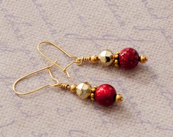 Red and gold-toned dangle earrings