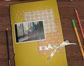 Notebook with yellow owl