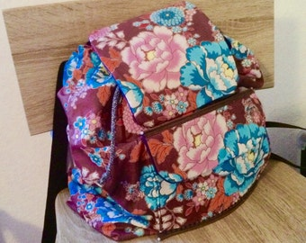 large floral backpack made of 100% cotton