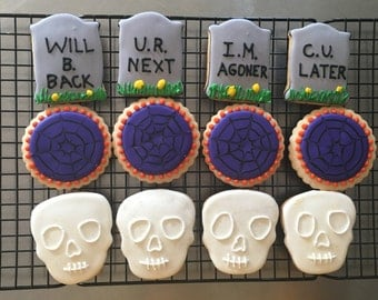Halloween theme sugar cookies, skull sugar cookies, tombstone sugar cookies, halloween cookie favors.  Order includes 1 dozen (12) cookies
