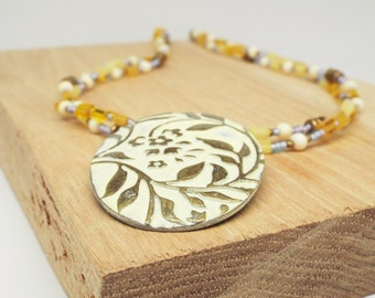 Flower Child - purple and yellow necklace with brass floral pendant