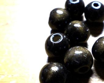 8 round beads in dark wood