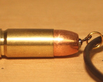 """Necklace. B.BLING: 38 cal hollow point bullet necklace (20"""" quality black stretch necklace)"""