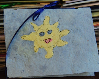 Handmade paper card with happy sun