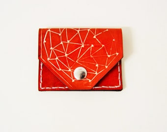 Wallet in leather embossed and dyed