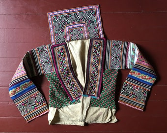 Vintage White Hmong jacket embellished with appliqué, reverse appliqué, and embroidery