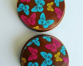 Chocolate covered oreo with butterfly detail