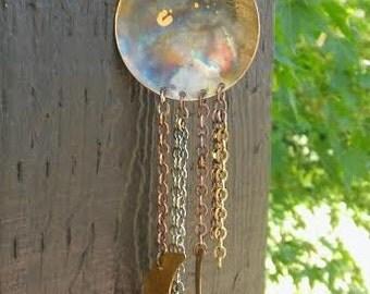 Planetary; a single earring