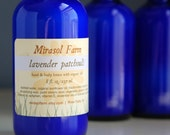 Lavender Patchouli lotion with organic coconut oil. Vegan lotion. Handmade in small batches. 8 ounce cobalt blue glass bottle.