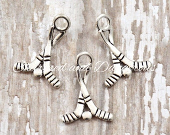 10 pewter Hockey Sticks charm (CM208)