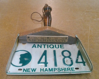 Antique NH license plate dust pan