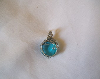 Wire wrapped ocean blue mosaic glass cabochon pendent