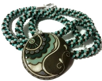 Blue, Brown & White Paisley Pendant On A Kumihimo Necklace