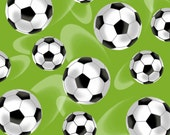 Green Tossed Soccer Balls Cotton Fabric from the Score Collection by First Blush Studio for Henry Glass Fabrics