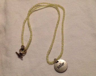 """Beaded necklace with """"Sister"""" charm"""