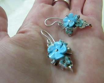 Earrings made of blackened silver with turquoise forget-me-nots