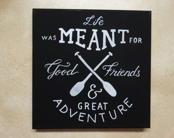 """Hand painted typography sign: """"Life was meant for good friends and great adventure """" White lettering on black canvas chalkboard style sign"""