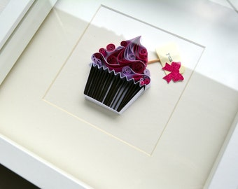 """Quilled paper artwork """"Cupcake"""" Framed in a white frame with glass."""
