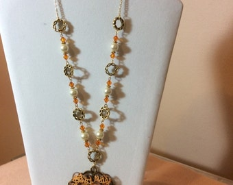 Necklace with an Orange pendant