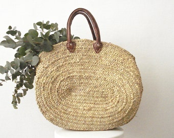Large oval basket and leather handles