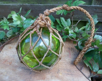 Fishing float, vintage, glass ball, ball glass catches light, rolled-up ball of macrame
