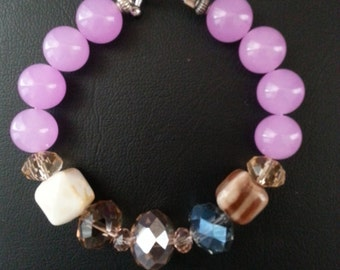 Purple Chalcedony bracelet with crystals.