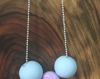 Pale blue and marbled clay necklace