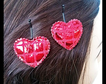 Sparkling red love hearts on bobby pins.