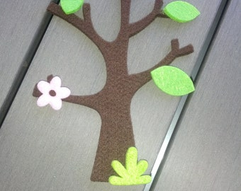 5 die-cut felt tree complete with flowers and leaves as shown on the picture. Suitable for decorations.