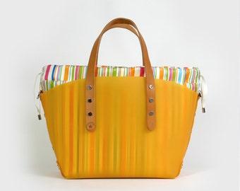 Orange striped bag with multicolored boat bag