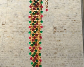 Sterling silver knitted bracelet, golden plated with emerald and ruby