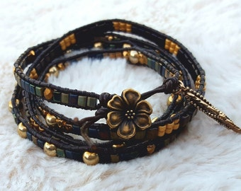 Bohemian leather 4-wrap bracelet with solid bronze feather charm.