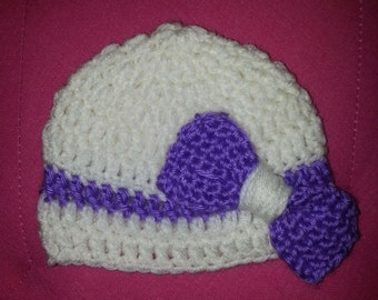 White and purple baby hat
