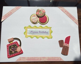 Birthday card with mounted makeup items