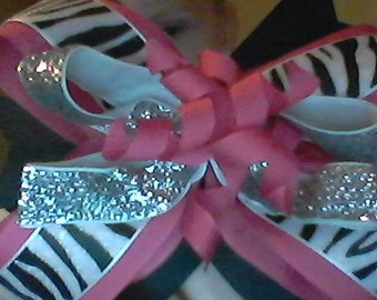 Cute boutique pink and black zebra bow