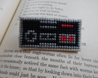NES cross stitch pin collectible