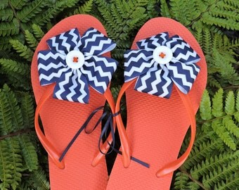 orange flops with navy zig zag ribbon flower