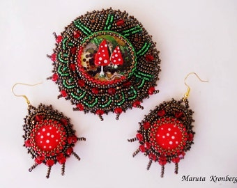bead embroidered brooch and earrings.
