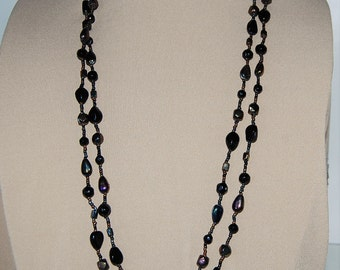 Vintage,double strand ,black and black iridescent glass beed  necklace.
