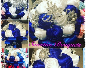 This beautiful bouquet Royal Blue and White with some amazing sparking brooches