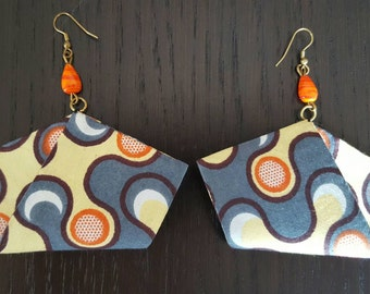 Multicolored curved cotton fabric earrings with small orange glass bead detail