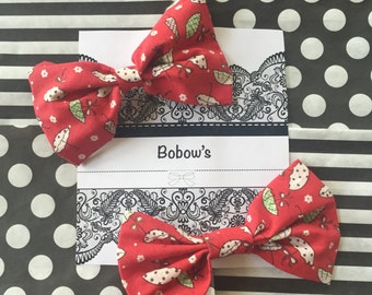 Large red umbrella hair bows